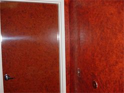 Walls painted to mach laminate on door.