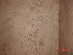 : Stenciling was used here to give the effect of a fossilized plant in the wall