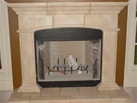 : This is a cast stone mantle that we finished to simulate sandstone